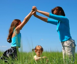 Mom with Girls in a Grassy Field