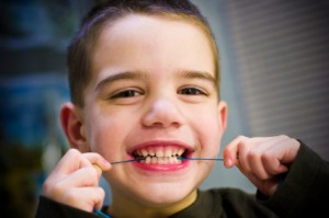 Kid Flossing Teeth
